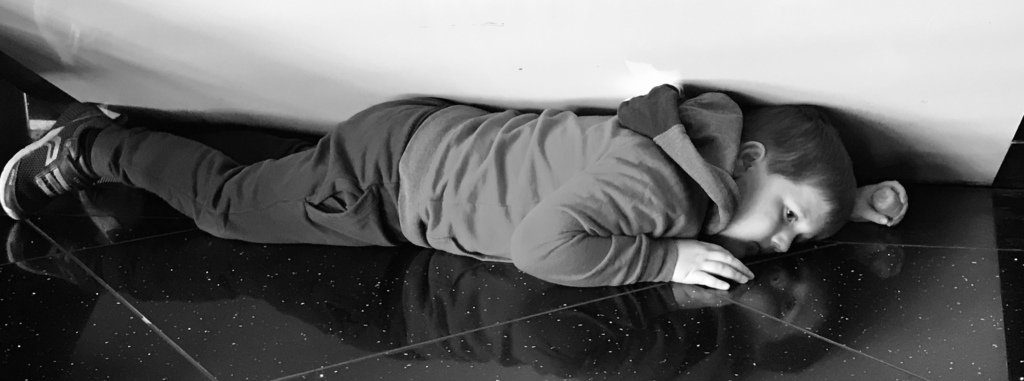 H lying down in public